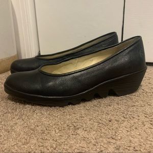 Fly London black leather wedge flats